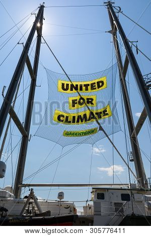 Burgas, Bulgaria - June 7, 2019: Text United For Climate On The Board Of Greenpeace Rainbow Warrior