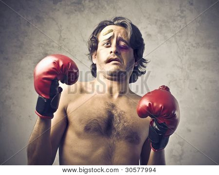 Wounded boxer with tired and frightened expression poster