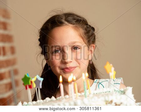 Beautiful little girl with birthday cake