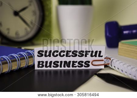 Successfull Business On The Paper Isolated On It Desk. Business And Inspiration Concept