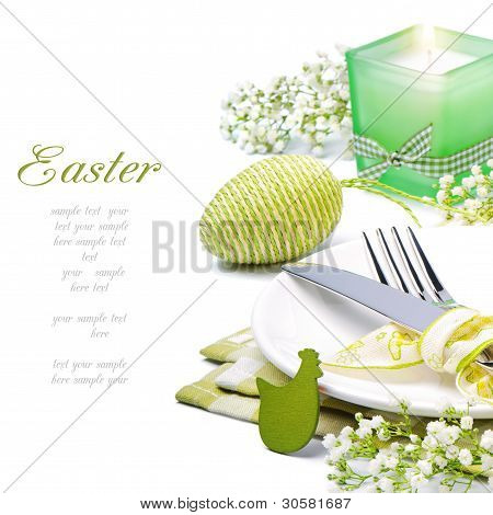 Easter Table Setting With Candle And Flowers