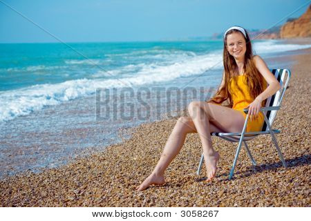 Happy Woman Resting At Beach