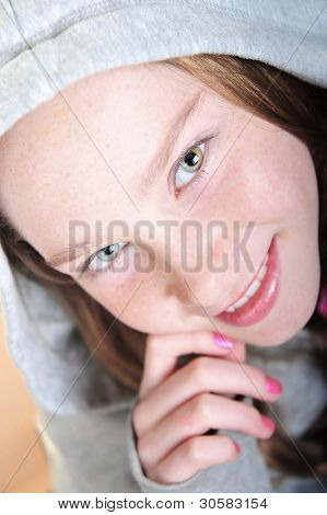 Young girl with freckles and pretty eyes