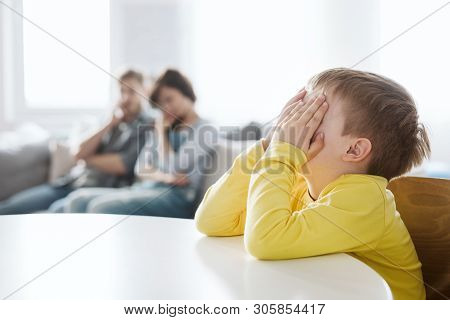 helpless parents and their badly behaving son at home poster