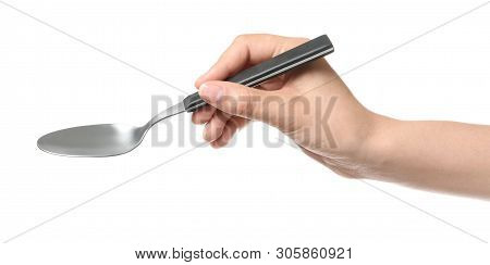 Woman Holding Clean Tablespoon On White Background, Closeup