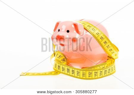 Credit Loan Debt. Measure Costs. Piggy Bank And Measuring Tape. Budget Limit Concept. Economics And