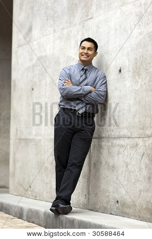 Hispanic Businessman - Leaning On Concrete Wall