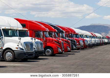 Las Vegas - Circa June 2019: International And Volvo Semi Tractor Trailer Trucks Lined Up For Sale.