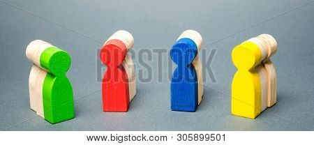 Groups Of Multicolored Wooden People. The Concept Of Market Segmentation. Customer Relationship Mana