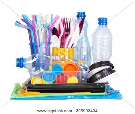Disposable single use plastic objects such as bottles, cups, forks, spoons and drinking straws that cause pollution of the environment, especially oceans. Isolated on white background.