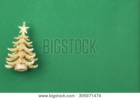 Image Shows An Golden X-mas Tree, Isolated On Green Background With Space For Text