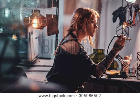 Beautiful Diligent Woman Is Doing Soldering At Her Own Artisan Lamp Studio.