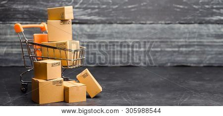 Wheelbarrow Supermarket With Boxes. Sales Of Products. The Concept Commerce, Online Shopping. E-comm