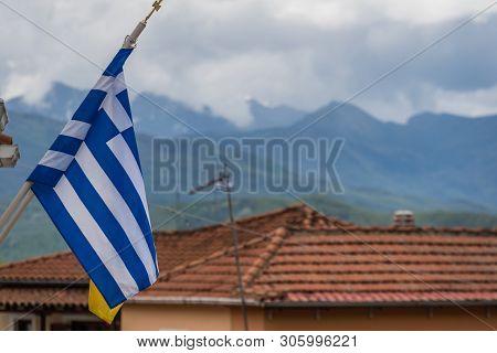Greek Flag On A Pole Outside Home In Kastraki Village In Meteora, Northern Greece