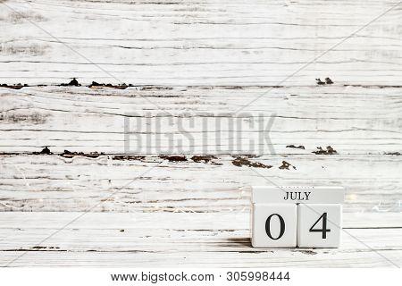 July 4Th Calendar Blocks Against Rustic White Background