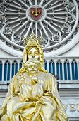 Golden baby Jesus sit on mother Mary poster