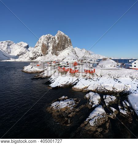 Breathtaking Winter View On Hamnoy Village And Festhaeltinden Mountain On Background. Popular Touris