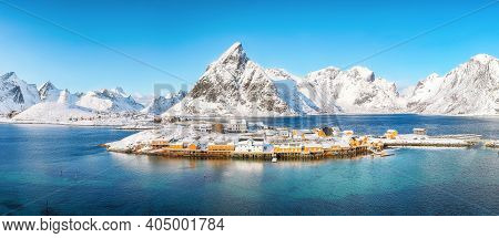 Aerial Winter View On Sakrisoy Village And Snowy Mountaines On Background. Popular Tourist Destinati