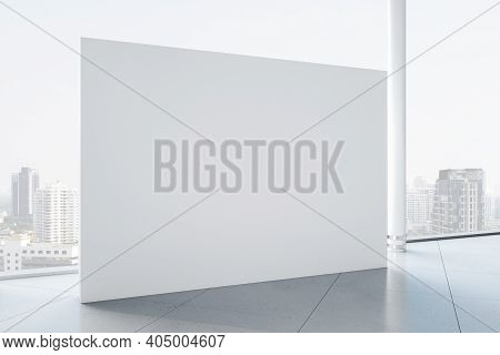 Bright Gallery Interior With Blank Exhibition Stand And City View. Gallery And Presentation Concept.