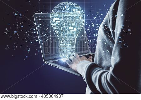 Hacker Using Laptop With Circuit Lamp On Abstract Dark Background. Engineering And Theft Concept
