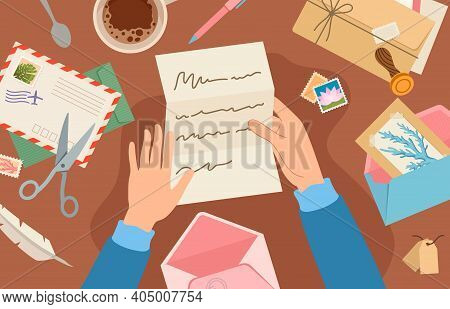 Hands Holding Mail On Desk. Woman Reading Paper Letter Sheet. Card And Envelope With Postal Stamp Li