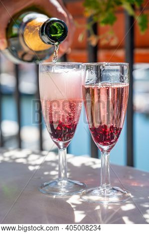 Summer Party With Sparkling Rose Champagne Wine And Sail Boats Haven Of Port Grimaud On Background,