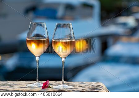Tasting Of Local Cold Rose Wine In Summer On Sunset With Sail Boats Haven Of Port Grimaud On Backgro