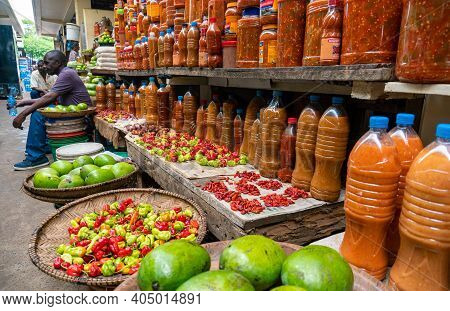 Dar Es Salaam, Tanzania - January 2020: Jars Of Peppers And Sauces In A Local Market In Dar Es Salaa