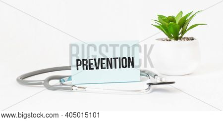 Prevention Word On Notebook,stethoscope And Green Plant