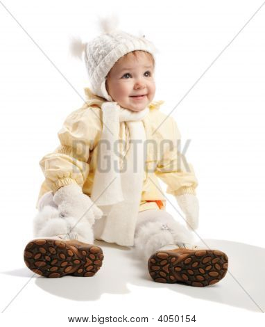 Smiling Toddler In Winter Clothes