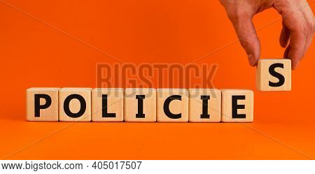 Policies Symbol. Concept Word 'policies' On Wooden Cubes On A Beautiful Orange Background. Businessm