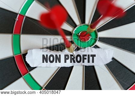 Business And Finance Concept. A Piece Of Paper With The Text Is Nailed To The Target With A Dart - N