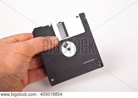 Old Computer And Data Storage Technology, Hand Held Black Plastic Magnetic Floppy Disk 3½ Inches, Is