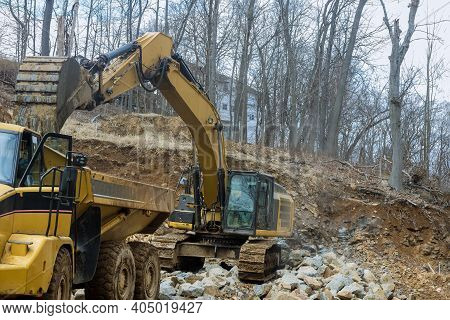 Loading Bucket Hydraulic Excavator A Stones The Excavator Is Loading Excavation To Dump Truck.