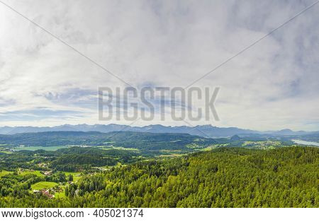 Austrial Landscape With Mountains, Forests And Alpine Lake Worthersee, Famous Tourist Attraction In