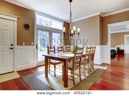 Large Bright Beige Dining Room With Cherry Hardwood.
