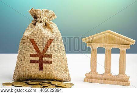 Yuan Or Yen Money Bag And Bank / Government Building. Budgeting, National Financial System. Monetary