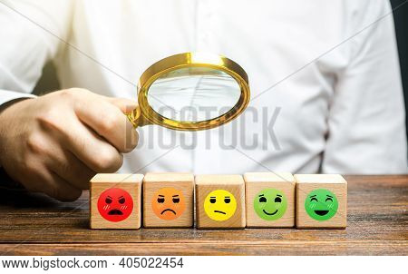 The Man Studies Blocks With Mood Symbols From Happily Satisfied To Angry Unsatisfied. Concept Of Rat