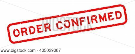Grunge Red Order Confirmed Word Square Rubber Seal Stamp On White Background