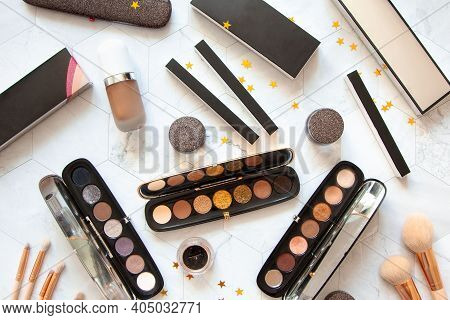 Flat Lay Composition Of Different Beauty Cosmetics Of Eyeliners, Eyeshadow Palette And Makeup Brushe