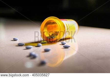 Prescription Medication Spilling Out With Shadows And Reflection. Depicting The Current Opioid Crisi