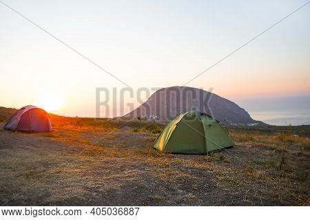 Installed Tourist Tent In The Mountains With A View Of The Sea And Sunrise. Domestic Tourism, Active