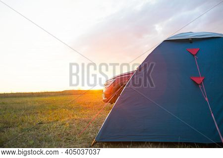Installed Tourist Tent Near The Car. Domestic Tourism, Active Summer Trip, Family Adventures, Auto C