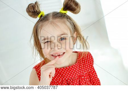 Little Girl Has No Tooth. The Child Has Lost A Baby Tooth. High Quality Photo
