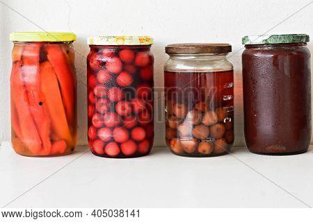 Variety Of Preserved Food In Glass Jars - Jam, Marmalade, Cherries, Red Pepper Preserving Vegetables