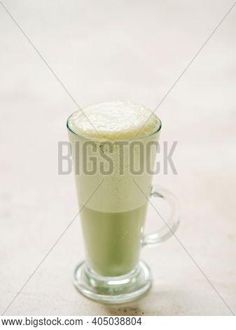 Matcha Green Tea Latte In Glass. Matcha Latte On Light Background. Copy Space. Vertical Vertical.