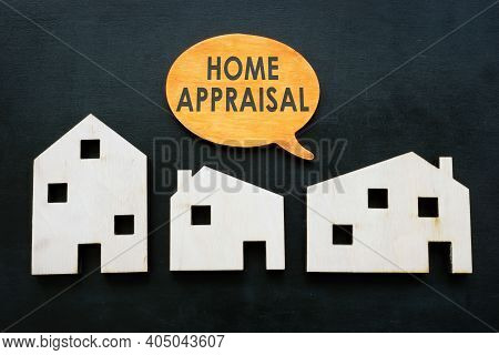 Models Of Houses And Quote Home Appraisal. Property Value Concept.