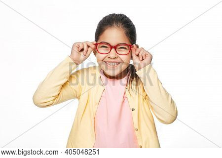 Vision Correction For Children Using Glasses. Portrait Asian Little Girl With Stylish Eyeglasses, Is
