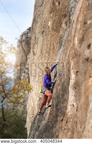 Sport Rock Climbing In Nature. The Girl Climbs The Cliff With The Insurance. Active Rest In Turkey.