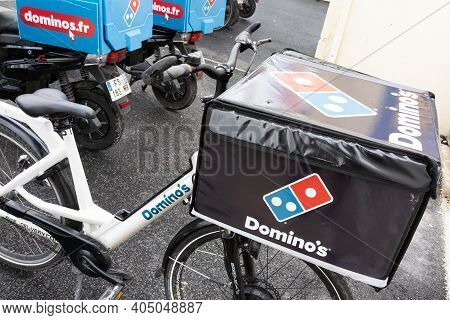 Bordeaux , Aquitaine  France - 01 24 2021 : Dominos Pizza Logo And Text Sign On Delivery Bike For Re